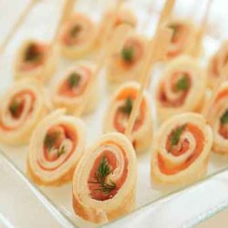 Rolled pancakes with salmon